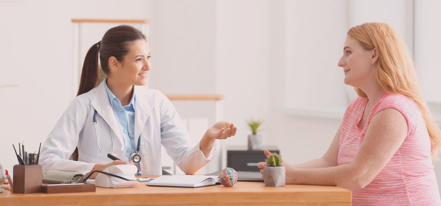 A woman engaging in a consultation with a doctor